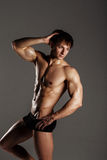 Muscular male model bodybuilder before training. Studio shot on Stock Photos
