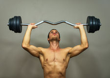 Muscular male model doing exercises. Royalty Free Stock Photo