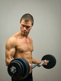 Muscular male model doing exercises. Stock Image