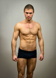 Muscular male model posing. Stock Image