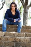 Muscular male model on stairs with sweat shirt. Muscular male model on stairs with sweatshirt Royalty Free Stock Photos