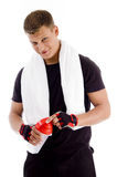 Muscular male opening the cap of water bottle Royalty Free Stock Photo
