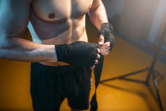 Muscular male person hands in black bandages Royalty Free Stock Photo