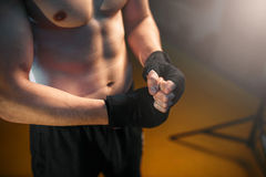 Muscular male person hands in black bandages Royalty Free Stock Photos