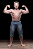 Muscular male shirtless in studio royalty free stock photo