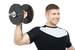 Muscular male showing his biceps Royalty Free Stock Photos