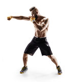 Muscular male in sports clothes сonducts fight with shadow. Photo of boxer on white background. Strength and motivation Royalty Free Stock Image
