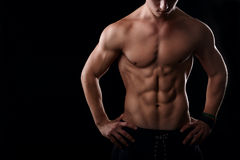 Muscular male stomach. Six pack abs on black background Stock Image