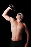 Muscular male swimmer refresh himself with water Royalty Free Stock Image