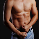 Muscular male torso. Male torso and hands clenched in a fist Stock Photo