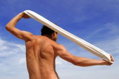 Muscular male torso. A muscular male torso holding white towel Stock Photos