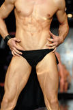 Muscular Male Torso. Athletic shirtless model with rippled muscles on fashion show Stock Images