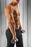 Muscular male torso on abstract background Royalty Free Stock Image