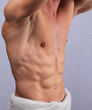 Muscular male torso, chest and armpit hair removal close up. Male Brazilian Waxing treatment Royalty Free Stock Photo