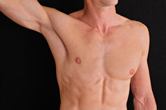 Muscular male torso, chest and armpit hair removal close up. Male waxing Stock Photo