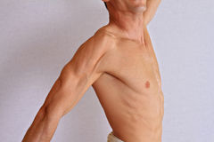 Muscular male torso, chest and armpit hair removal close up. Male waxing Royalty Free Stock Photos