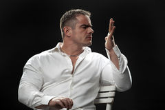 Muscular male in a white shirt Royalty Free Stock Photo