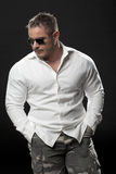 Muscular male in a white shirt standing Stock Photo