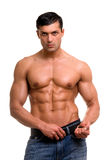 Muscular man. Beautiful man with muscular body holding the belt Stock Image