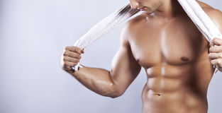 Muscular man. Handsome muscular men with towel Stock Image