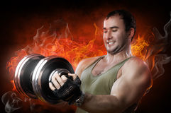 Muscular man. Powerful muscular man lifting weights Royalty Free Stock Photography