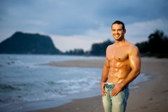 Muscular man. Muscular young man on beach Stock Photos