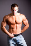 Muscular man. Young muscular man flexing his muscles Stock Photography
