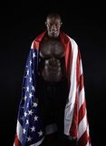 Muscular man with American flag Royalty Free Stock Image