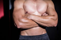Muscular man with arms crossed Stock Photos
