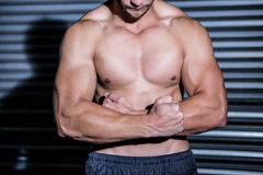 Muscular man with arms crossed Royalty Free Stock Image