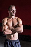 Muscular man with arms crossed Royalty Free Stock Images