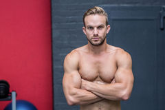 Muscular man with arms crossed Royalty Free Stock Photos