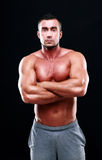 Muscular man with arms folded Royalty Free Stock Image