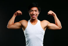 Muscular man with arms stretched out Stock Photo
