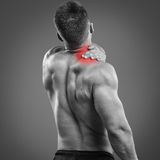 Muscular man Back Neck pain Stock Photo