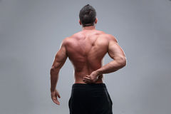 Muscular man with back pain Royalty Free Stock Images