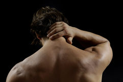 Muscular man with back pain. Isolated Stock Photos