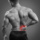 Muscular man Back pain Royalty Free Stock Photography