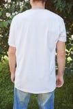 Muscular man back wearing white blank t-shirt Royalty Free Stock Image