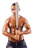 Muscular man with baseball bat Stock Photos