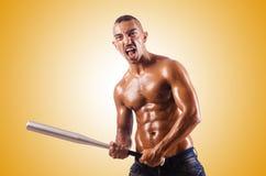 Muscular man with baseball bat Stock Photos