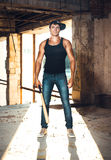 Muscular man with baseball bat Stock Photo