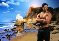 Muscular man at beach stock photography