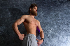 Muscular man with the beard posing Royalty Free Stock Image