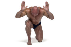 Muscular man bending on knee with arms raised Stock Image
