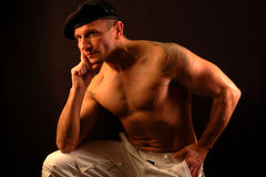 Muscular man with beret Royalty Free Stock Image