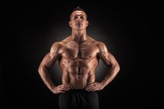 Muscular man on black background Royalty Free Stock Photos