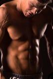 Muscular man bodybuilder , abdominal muscle. Abdominal muscle of muscular man royalty free stock photos