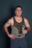 Muscular man with bottled water Royalty Free Stock Image