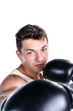Muscular man boxing Stock Photography
